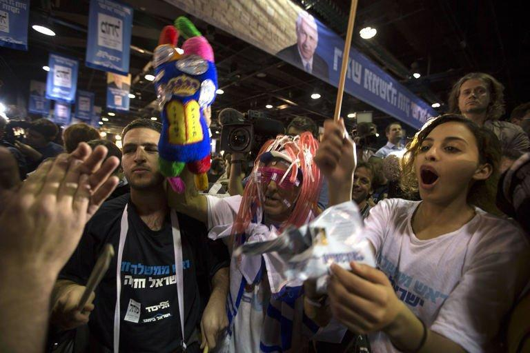 Israeli Likud Party supporters celebrate after the exit polls were announced on January 22, 2013 at the party's headquarters in Tel Aviv. Israeli Prime Minister Benjamin Netanyahu's Likud-Beitenu list was the top vote getter in today's election but the rightwing combination was weakened by a strong showing by the centrist Yesh Atid, according to TV exit polls