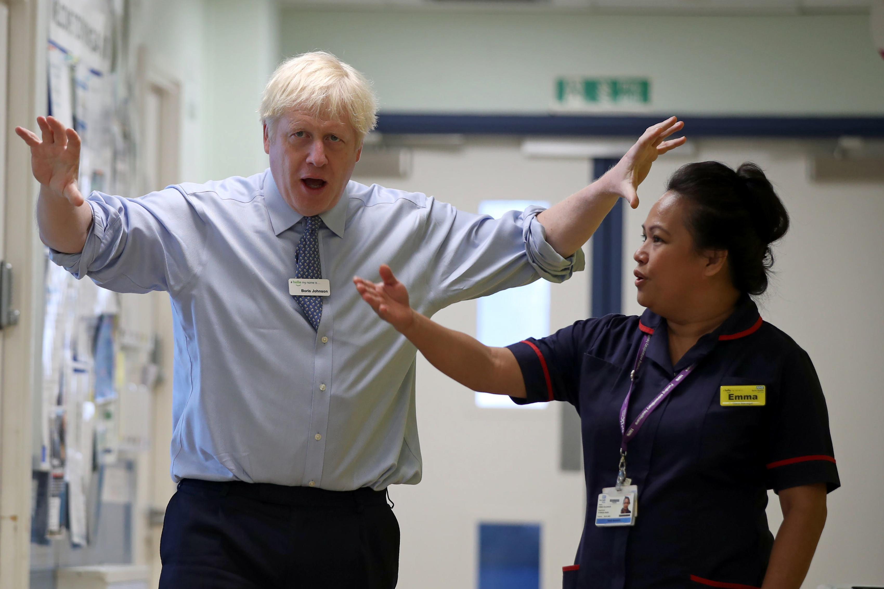 Britain's Prime Minister Boris Johnson (L) gestures during his visit to Whipps Cross University Hospital in Leytonstone, east London on September 18, 2019. (Photo by Yui Mok / POOL / AFP) (Photo credit should read YUI MOK/AFP/Getty Images)