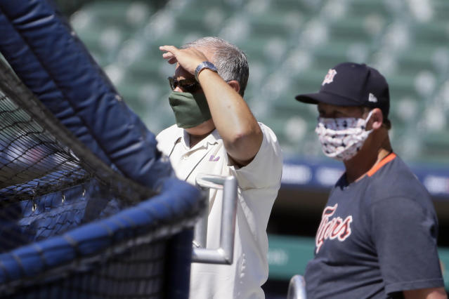 Detroit Tigers general manager Al Avila, left, watches batting practice during baseball training camp at Comerica Park Friday, July 3, 2020, in Detroit. (AP Photo/Duane Burleson)