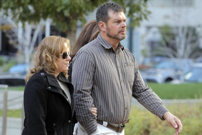 Eric Jensen, 37, one of two brothers who owned and operated Jensen Farms, arrives at the federal courthouse in Denver, on Tuesday, Oct. 22, 2013, with family. The two Colorado farmers whose cantaloupes were tied to a 2011 listeria outbreak that killed 33 people pleaded guilty on Tuesday to misdemeanor charges under a deal with federal prosecutors.(AP Photo/Ed Andrieski)