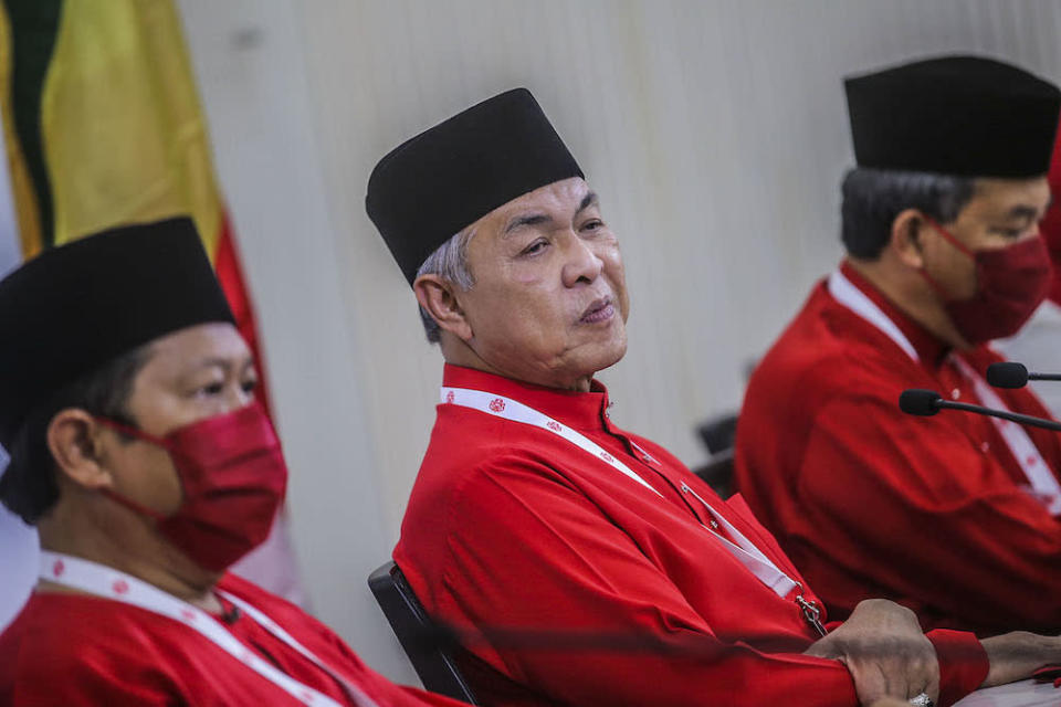 During the general assembly, Umno president Datuk Seri Ahmad Zahid Hamidi (centre) warned 'parasites' within the party to not support PN or Bersatu. ― Picture by Hari Anggara