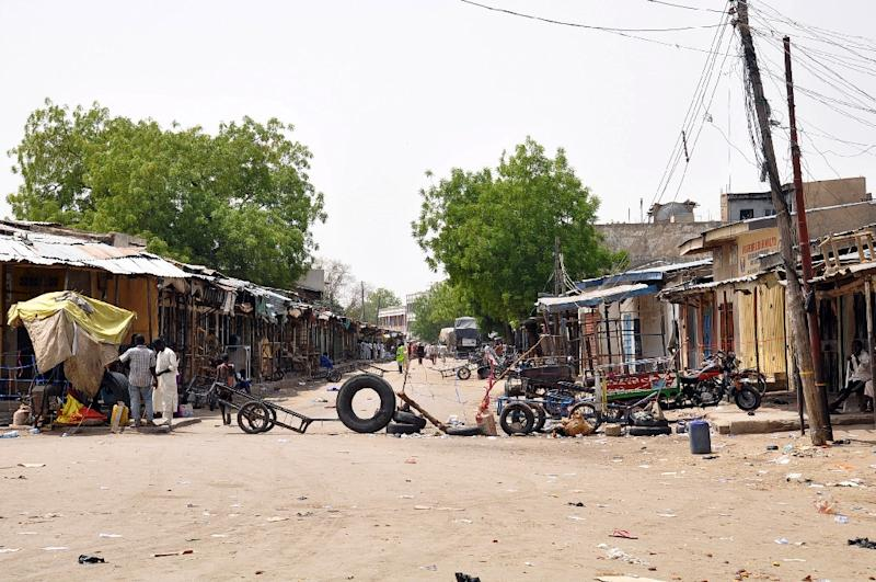 The road to the Monday Market is blocked after a blast in Maiduguri, on March 7, 2015 (AFP Photo/Tunji Omirin)