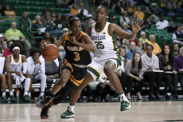 Grambling State guard Brandi Washington (3) works to get to the basket against Baylor center Queen Egbo (25) in the first half of an NCAA college basketball game in Waco, Texas, Friday, Nov. 8, 2019. (AP Photo/Tony Gutierrez)