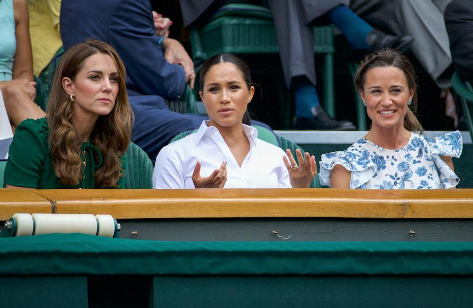 Catherine, Duchess of Cambridge sits with Meghan, Duchess of Sussex, and Pippa Middleton in the Royal Box on Centre Court ahead of the Ladies Singles Final between Simona Halep of Romania and Serena Williams of the United States on Centre Court during the Wimbledon Lawn Tennis Championships at the All England Lawn Tennis and Croquet Club at Wimbledon on July 13, 2019 in London, England.