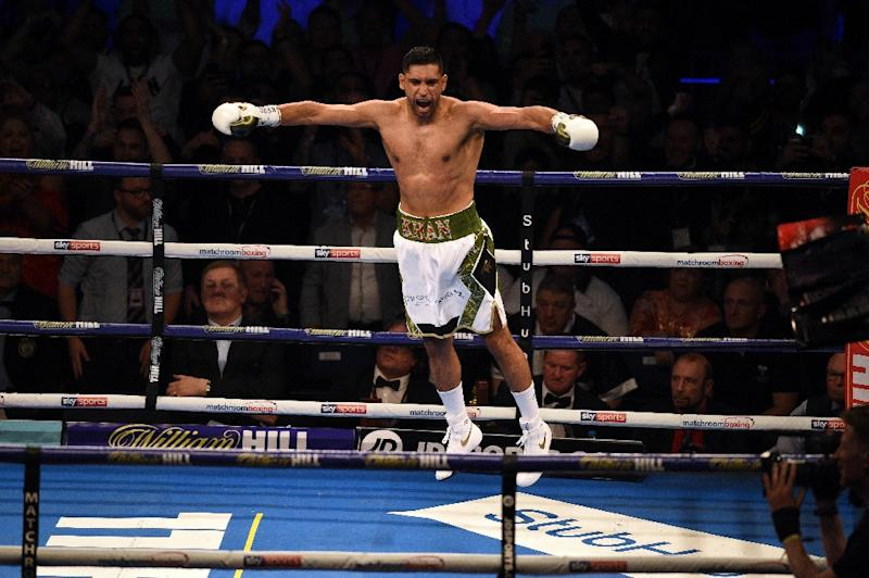High about that!: Amir Khan celebrates his 39-second win on Saturday
