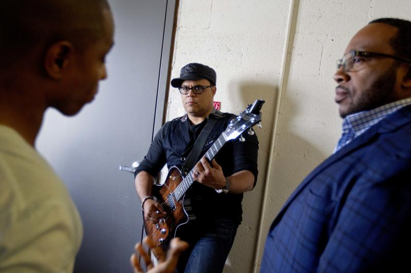 In this June 11, 2012 photo, gospel singers Kirk Franklin, from left, Israel Houghton and Marvin Sapp, wait backstage before taping a television show in Atlanta. There is a lot riding on the expanding brand of gospel music through the upcoming King's Men concert tour featuring Kirk Franklin, Marvin Sapp, Donnie McClurkin and Israel Houghton. The King's Men concert series will be the first gospel tour backed by Live Nation Inc., the world's largest concert promoter. It's also the first step toward proving that the genre can broaden its fan base and become a lucrative business for the promotional company. (AP Photo/David Goldman)