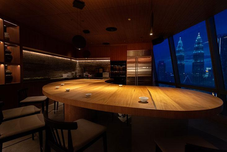 Dewakan's test kitchen can also be a venue for a small, intimate dinner with a killer view of the Petronas Twin Tower – Picture courtesy of Dewakan's Facebook