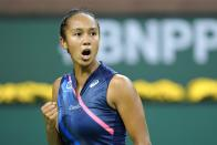 Leylah Fernandez celebrates winning a point over Alize Cornet, of France, at the BNP Paribas Open tennis tournament Friday Oct. 8, 2021, in Indian Wells, Calif. (AP Photo/Mark J. Terrill)