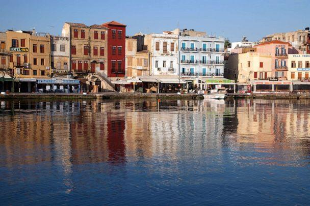 PHOTO: Old Harbor reflects in water, Chania, Crete, Greece (Danita Delimont/Getty Images/Gallo Images)