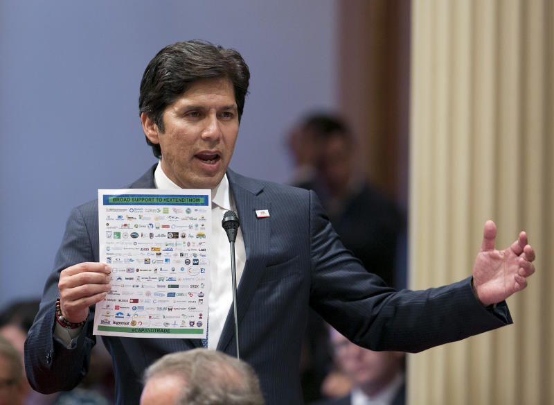 FILE - In this July 17, 2017, file photo, Sen. President Pro Tem Kevin de Leon, D-Los Angeles, displays a list of various backers of a climate change bill in Sacramento, Calif. The Senate approved Assembly Bill 398, a bill to extend California's cap-and-trade bill, and sent it to the Assembly for a final vote. Democrat Kevin de Leon, president of California State Senate, announced Sunday, Oct. 15, 2017 he will challenge Sen. Dianne Feinstein in next year's election. (AP Photo/Rich Pedroncelli, File)