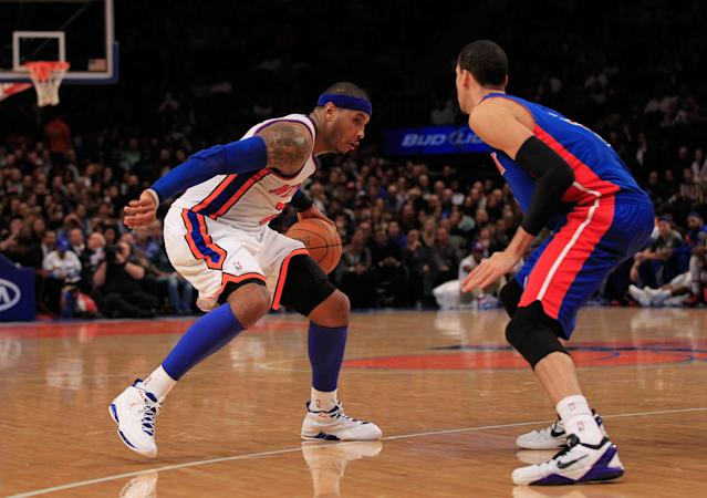 NEW YORK, NY - JANUARY 31: Carmelo Anthony #7 of the New York Knicks drives against Austin Daye #5 of the Detroit Pistons at Madison Square Garden on January 31, 2012 in New York City. NOTE TO USER: User expressly acknowledges and agrees that, by downloading and or using this photograph, User is consenting to the terms and conditions of the Getty Images License Agreement. (Photo by Chris Trotman/Getty Images)
