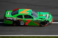 DAYTONA BEACH, FL - FEBRUARY 25: Danica Patrick drives the wrecked #7 GoDaddy.com Chevrolet down pit lane after being involved in an on track incident during the NASCAR Nationwide Series DRIVE4COPD 300 at Daytona International Speedway on February 25, 2012 in Daytona Beach, Florida. (Photo by Tom Pennington/Getty Images for NASCAR)