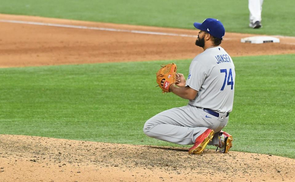 Dodgers reliever Kenley Jansen drops to his knees after giving up a single on the final play of Game 4 of the World Series.