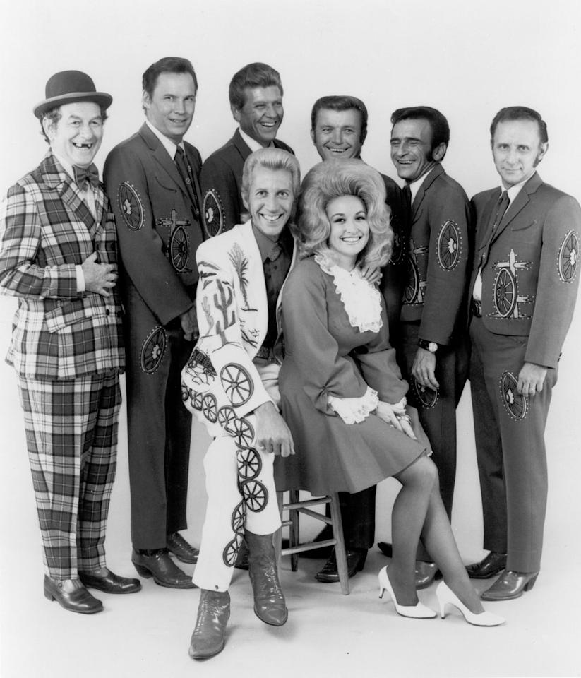 <p>Young Dolly smiles here with her good friend Porter Wagoner and the rest of his show's cast.</p>
