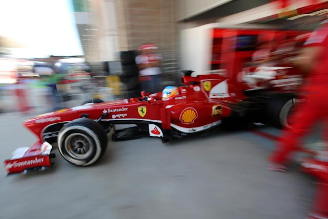 Ferrari driver Fernando Alonso of Spain steers his car out of his team garage during the second practice session for the Korean Formula One Grand Prix at the Korean International Circuit in Yeongam, South Korea, Friday, Oct. 4, 2013.(AP Photo/Aaron Favila)