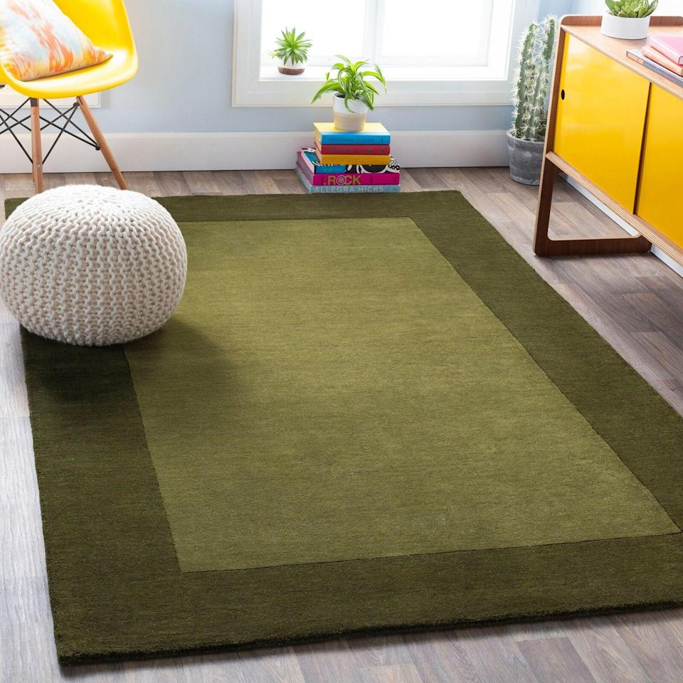 "<br><br><strong>Winston Porter</strong> Flatweave Wool Dark Green Rug, $, available at <a href=""https://go.skimresources.com/?id=30283X879131&url=https%3A%2F%2Fwww.wayfair.com%2Frugs%2Fpdp%2Fwinston-porter-bradley-handmade-flatweave-wool-dark-green-rug-wnpr4324.html%3Fpiid%3D22223413"" rel=""nofollow noopener"" target=""_blank"" data-ylk=""slk:Wayfair"" class=""link rapid-noclick-resp"">Wayfair</a>"