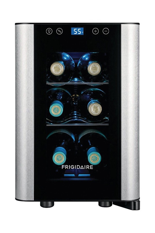 """<p><strong>Frigidaire</strong></p><p>target.com</p><p><strong>$139.99</strong></p><p><a href=""""https://go.redirectingat.com?id=74968X1596630&url=https%3A%2F%2Fwww.target.com%2Fp%2Ffrigidaire-6-bottle-stainless-steel-wine-cooler-black-ffwc0622us%2F-%2FA-53795947&sref=http%3A%2F%2Fwww.goodhousekeeping.com%2Fappliances%2Fg30124663%2Fbest-wine-fridges%2F"""" target=""""_blank"""">Shop Now</a></p><p>This stainless steel and black Frigidaire holds six bottles and stands just over 15-inches tall. It's quiet and fits under the kitchen counter (or on top of it), with LED interior lighting for a sleek look. Reasonably priced, this small wine fridge is a good choice for the casual wine drinker or to give as a gift. </p><p><strong>RELATED:</strong> <a href=""""https://www.goodhousekeeping.com/holidays/gift-ideas/g4708/wine-gifts/"""" target=""""_blank"""">40+ Gifts for Wine Lovers That Go Beyond a Boring Bottle of Pinot</a></p>"""