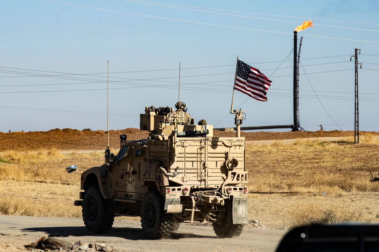 A US military armoured vehicle drives in a patrol past an oil well in Rumaylan (Rmeilan) in Syria's northeastern Hasakeh province on November 6, 2019. (Photo: Delil Souleiman/AFP via Getty Images)