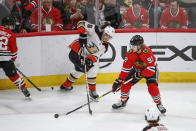 Chicago Blackhawks left wing Alex Nylander (92) works for the puck against Anaheim Ducks center Isac Lundestrom (48) during the second period of an NHL hockey game Saturday, Jan. 11, 2020, in Chicago. (AP Photo/Kamil Krzaczynski)