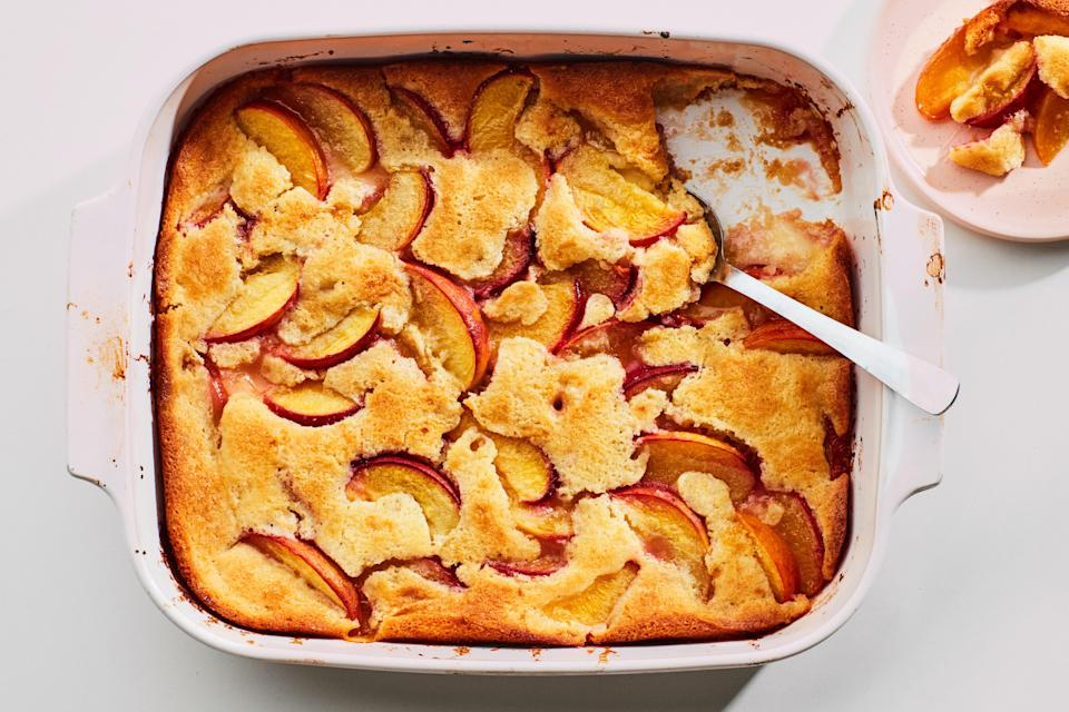 """In this cobbler recipe, the batter puffs up around the fruit, creating a cakey top and a gooey base. <a href=""""https://www.epicurious.com/recipes/food/views/southern-one-cup-peach-cobbler?mbid=synd_yahoo_rss"""" rel=""""nofollow noopener"""" target=""""_blank"""" data-ylk=""""slk:See recipe."""" class=""""link rapid-noclick-resp"""">See recipe.</a>"""