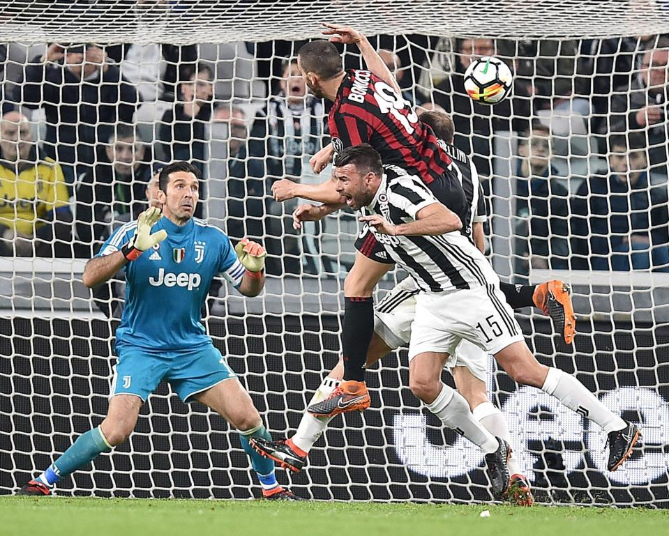 FILE - In this March 31, 2018 file photo Milan's Leonardo Bonucci scores his team's first goal during the Italian Serie A soccer match between Juventus and Milan at the Allianz Stadium in Turin. Bonucci won six Serie A titles in seven years at Juventus but the Italy defender joined Milan last year _ in what was the shock of the transfer window _ for a fee of more than 40 million euros ($45 million) amid reports of a dressing room spat. Juventus said on Thursday that the 31-year-old Bonucci, who has reportedly taken a pay cut to move back to Juventus, has signed a five-year deal. (Alessandro Di Marco/ANSA via AP)