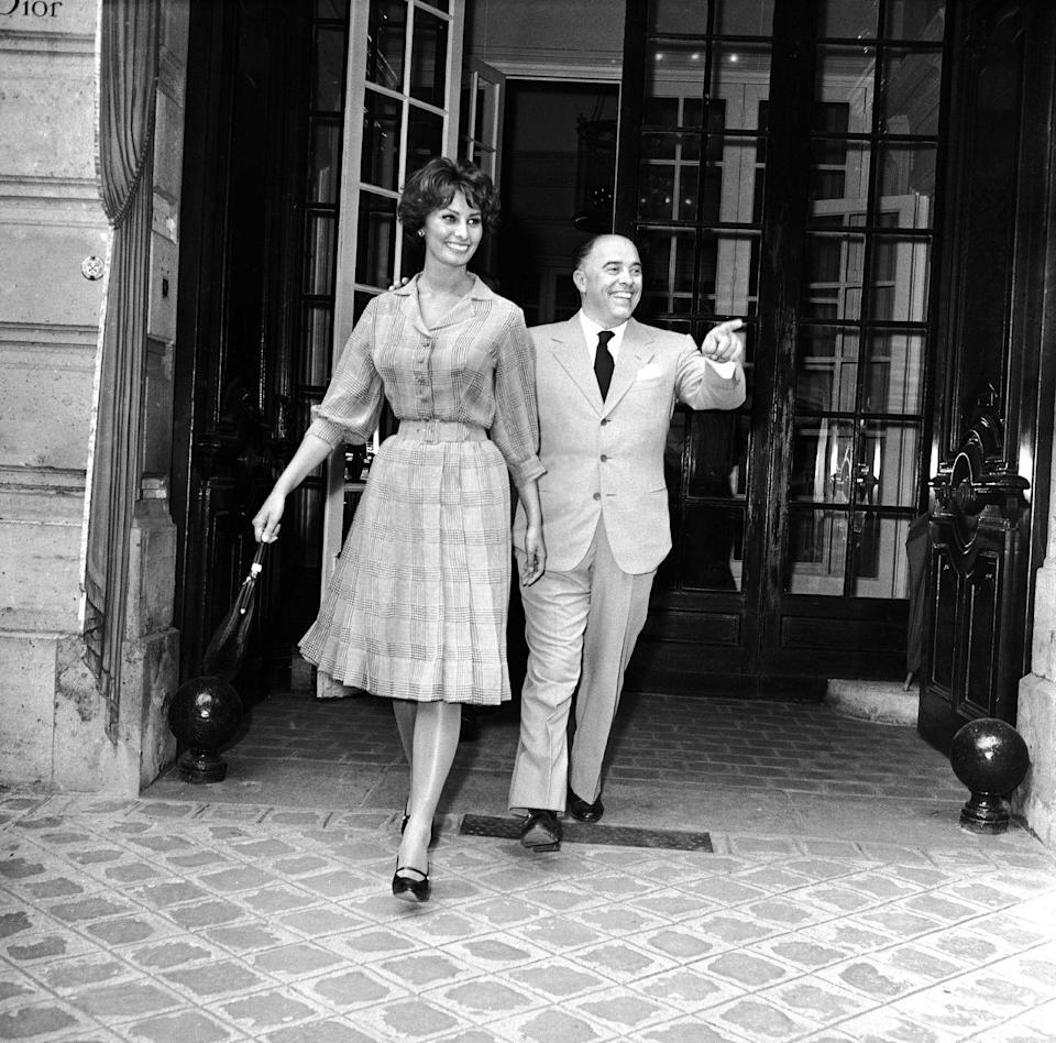 <p>Sophia Loren and her husband, Carlo Ponti, are all smiles outside of Christian Dior in Paris. The Italian beauty reportedly tried on a few pairs of shoes before leaving the store.</p>