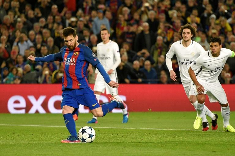 Barcelona's forward Lionel Messi kicks to score on a penalty during the UEFA Champions League round of 16 second leg football match against Paris Saint-Germain FC at the Camp Nou stadium in Barcelona on March 8, 2017