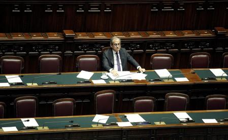 FILE PHOTO: Italian Economy Minister Giovanni Tria is seen in parliament as he speaks over the looming EU disciplinary action against Italy for excessive debt, in Rome