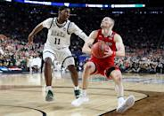 Matt Mooney #13 of the Texas Tech Red Raiders handles the ball against Aaron Henry #11 of the Michigan State Spartans in the second half during the 2019 NCAA Final Four semifinal at U.S. Bank Stadium on April 6, 2019 in Minneapolis, Minnesota. (Photo by Streeter Lecka/Getty Images)