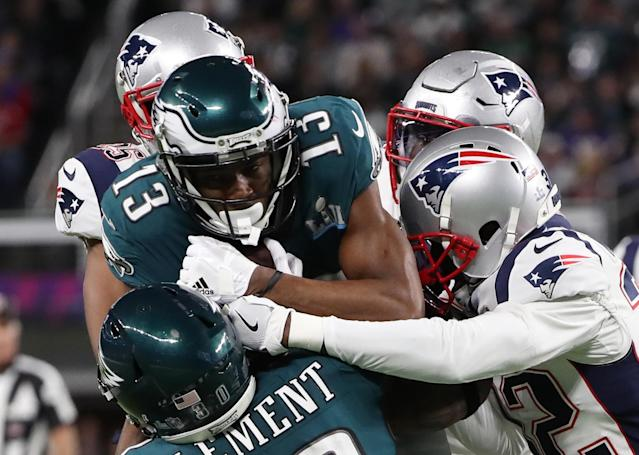 NFL Football - Philadelphia Eagles v New England Patriots - Super Bowl LII - U.S. Bank Stadium, Minneapolis, Minnesota, U.S. - February 4, 2018. Philadelphia Eagles' Nelson Agholor and Corey Clement in action with New England Patriots' Devin McCourty. REUTERS/Chris Wattie