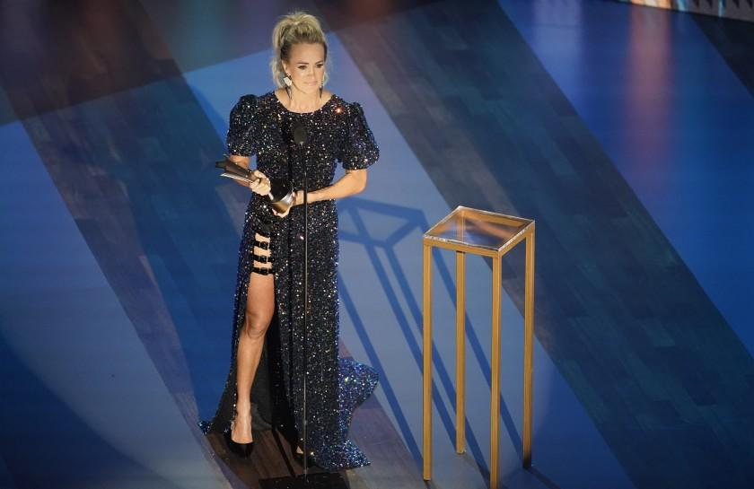 Carrie Underwood accepts the entertainer of the year award during the 55th annual Academy of Country Music Awards at the Grand Ole Opry House on Wednesday, Sept. 16, 2020, in Nashville, Tenn. (AP Photo/Mark Humphrey)