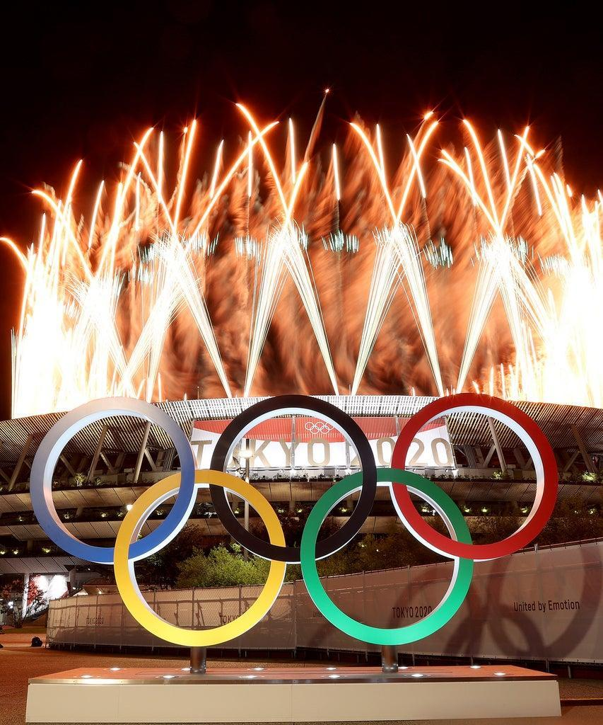 TOKYO, JAPAN – JULY 23: The Olympic Rings are seen outside the stadium as fireworks go off during the Opening Ceremony of the Tokyo 2020 Olympic Games at Olympic Stadium on July 23, 2021 in Tokyo, Japan. (Photo by Lintao Zhang/Getty Images)
