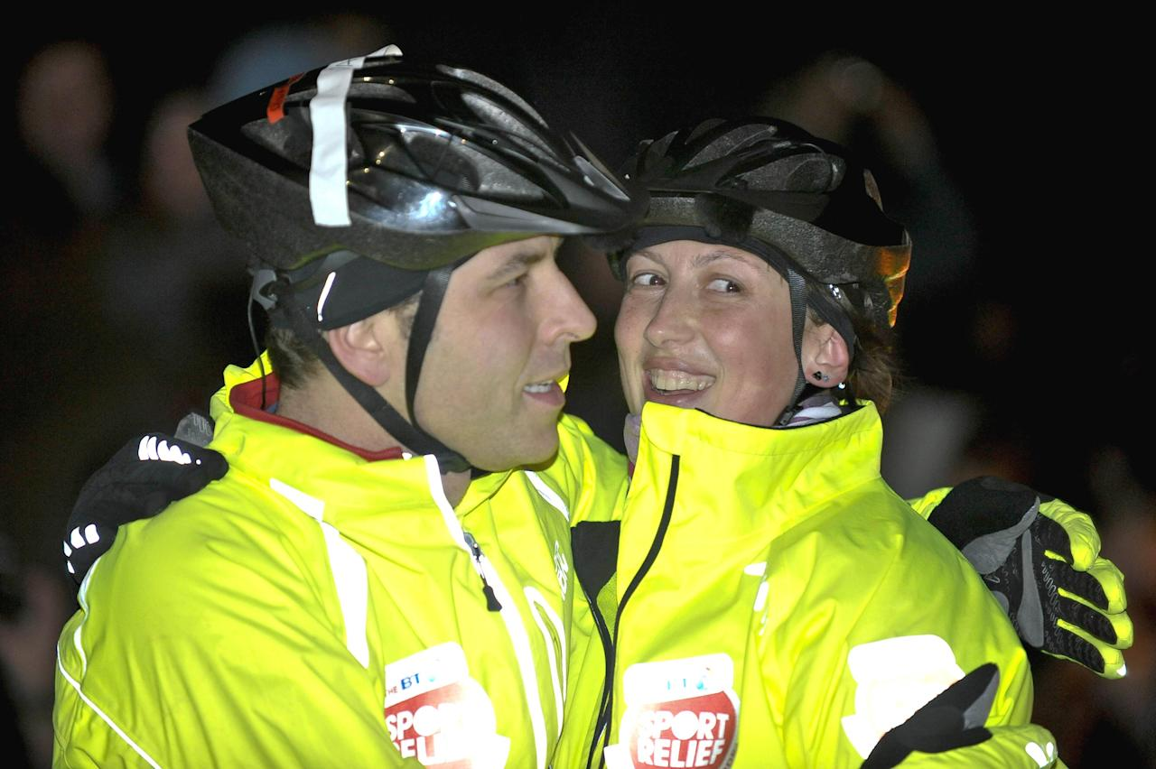 David Walliams hugs Miranda Hart after crossing the finishing line, at Lands End, of the BT Sport Relief Million Pound Bike Ride, this evening.   (Photo by Ben Birchall/PA Images via Getty Images)