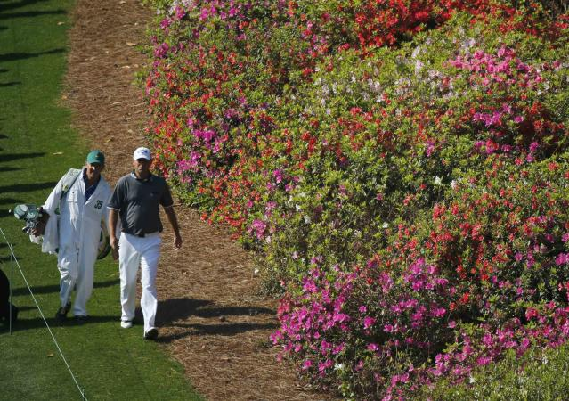 Denmark's Thomas Bjorn and his caddie (L) walk down the sixth fairway during the second round of the Masters golf tournament at the Augusta National Golf Club in Augusta, Georgia April 11, 2014. REUTERS/Mike Blake (UNITED STATES - Tags: SPORT GOLF)