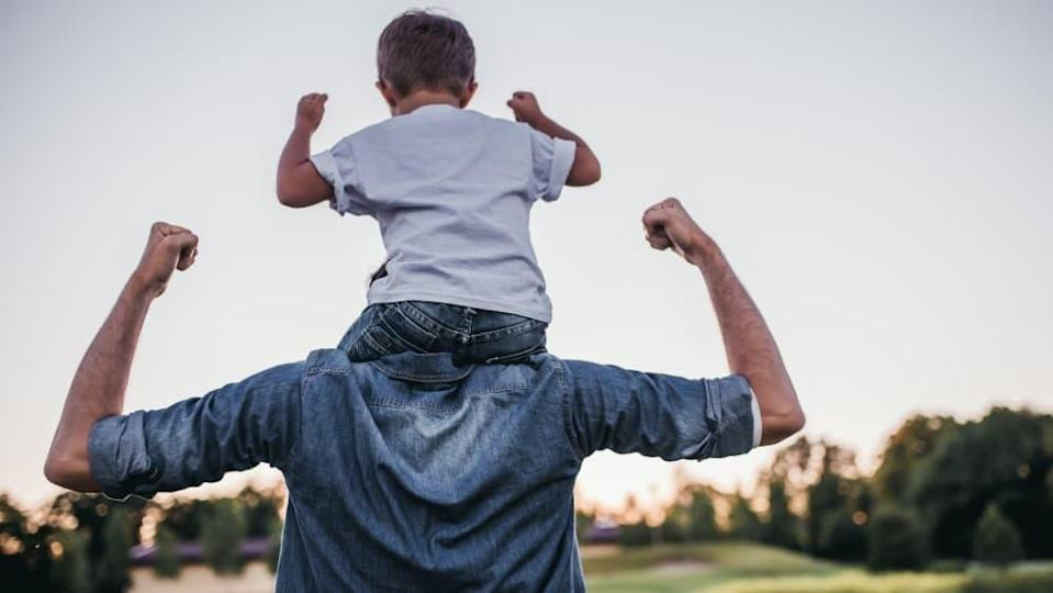 Dad and son having fun outdoor. Healthy living concept