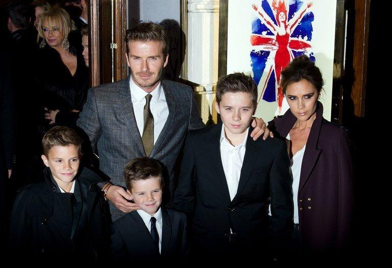 David and Victoria Beckham pose on the red carpet with three of their children, (L-R) Romeo, Cruz and Brooklyn in central London, December 11, 2012. Beckham, who will be visiting China next week with his wife, is being tasked with promoting the Chinese league