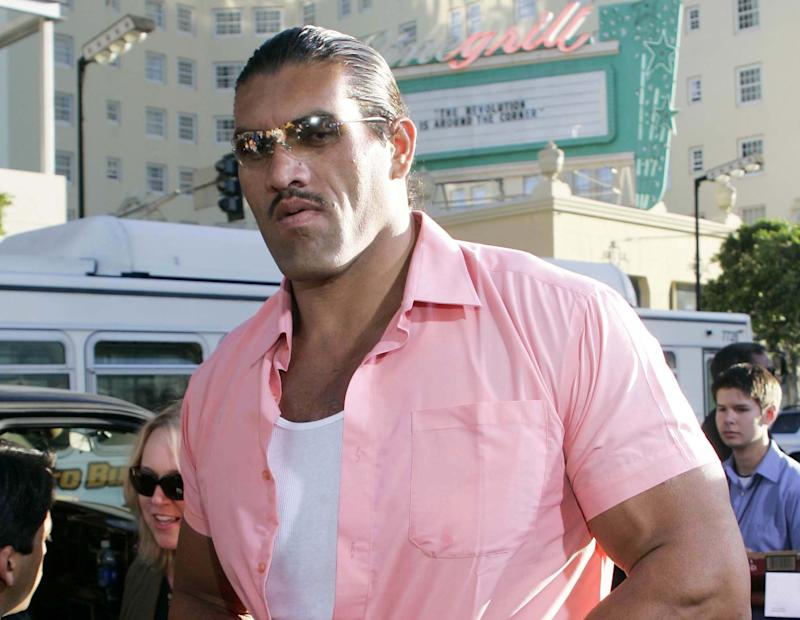 "FILE - This May 19, 2005 file photo shows actor Dalip Singh, of India, arriving at the world premiere of ""The Longest Yard"" in the Hollywood portion of Los Angeles. On Wednesday, July 25, 2012, doctors at UPMC Presbyterian in Pittsburgh removed a pituitary gland tumor that's the cause of his formidable size. Hospital spokeswoman Susan Manko says Singh, is recovering well and is expected to be released over the weekend.(AP Photo/Danny Moloshok, file)"