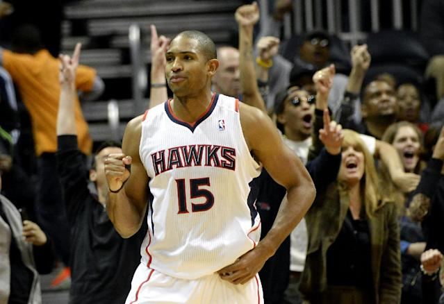 The crowd reacts as Atlanta Hawks center Al Horford (15) pumps his fist after hitting a jumper at the buzzer in overtime to win over the Washington Wizards in an NBA basketball game on Friday, Dec. 13, 2013, in Atlanta. Atlanta won 101-99. (AP Photo/David Tulis)