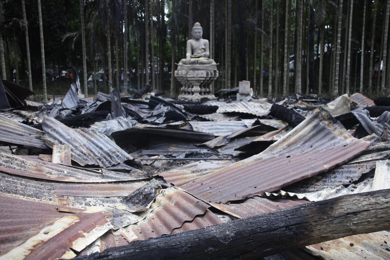A Buddha statue stands amidts the ruins of a Buddhist temple that was torched in Ramu in the coastal district of Cox's Bazar, Bangladesh, Sunday, Sept. 30, 2012. Thousands of Bangladeshi Muslims angry over an alleged derogatory photo of the Islamic holy book Quran on Facebook set fires in at least 10 Buddhist temples and 40 homes near the southern border with Myanmar, authorities said Sunday. (AP Photo)