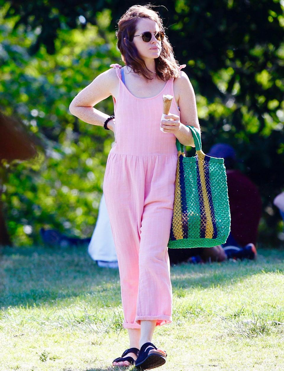 <p>Claire Foy enjoys a sweet treat as she heads to a socially distanced hangout with a friend in London on Tuesday.</p>