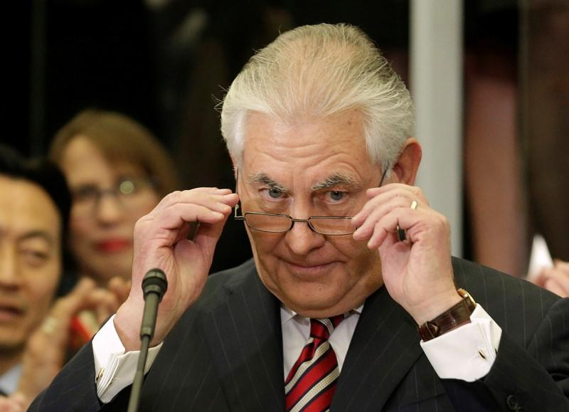 U.S. Secretary of State Rex Tillerson removes his glasses after delivering remarks to Department of State employees upon arrival at the Department of State in Washington
