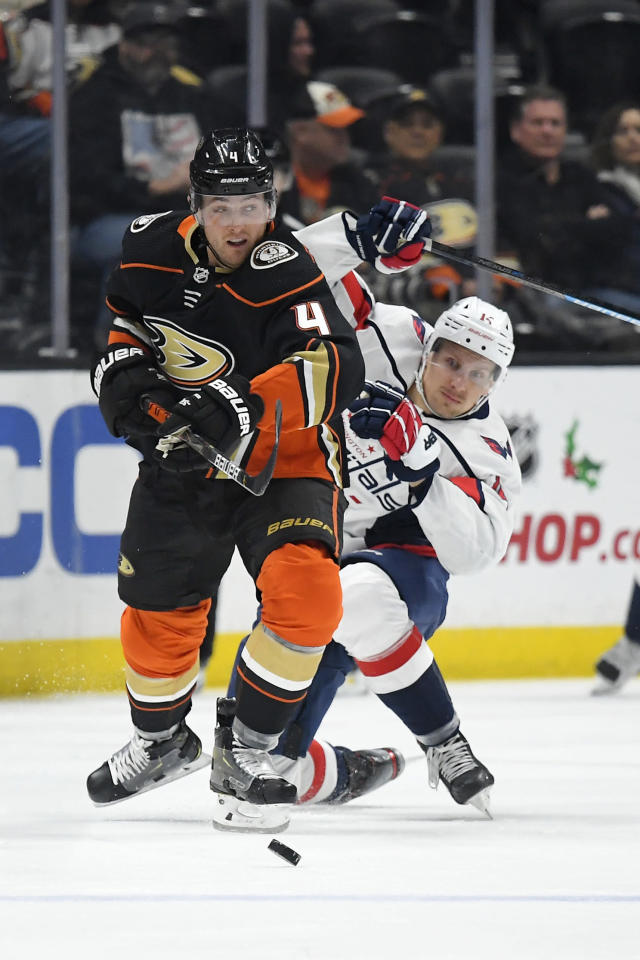 Anaheim Ducks defenseman Cam Fowler, left, and Washington Capitals right wing Richard Panik vie for the puck during the first period of an NHL hockey game Friday, Dec. 6, 2019, in Anaheim, Calif. (AP Photo/Mark J. Terrill)