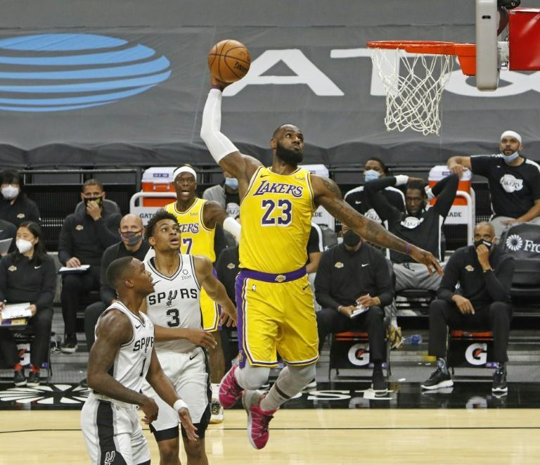 Ageless: Los Angeles superstar LeBron James soars for a dunk in the Lakers' 121-107 NBA victory over the San Antonio Spurs on his 36th birthday