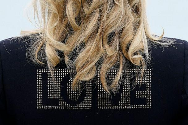 PHOTO: First lady Jill Biden turns around to show the word 'love' on the back of her jacket as she speaks with reporters after visiting with Carrie Johnson, wife of British Prime Minister Boris Johnson, June 10, 2021, in Carbis Bay, England. (Patrick Semansky/AP)
