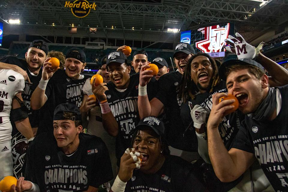 Aggies players celebrate their Orange Bowl victory over the Tar Heels in January.