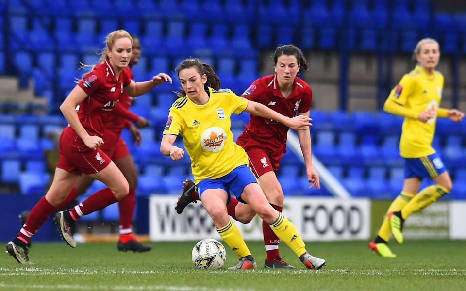 Niamh Fahey of Liverpool competes with Chloe Arthur of Birmingham - Liverpool FC