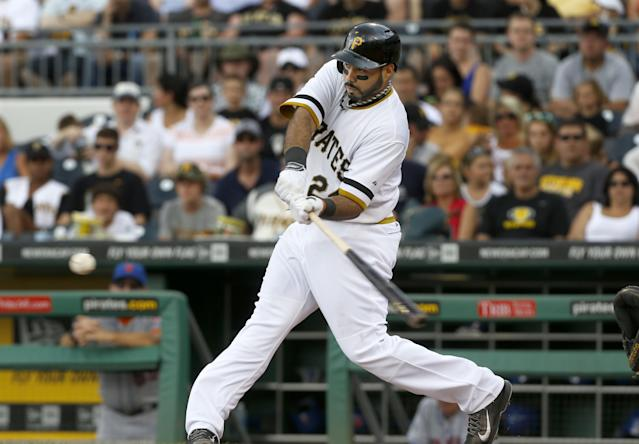 Pittsburgh Pirates' Pedro Alvarez hits a pitch for a single to drive in Josh Harrison from first in the first inning of the baseball game on Sunday, June 29, 2014, in Pittsburgh. (AP Photo/Keith Srakocic)