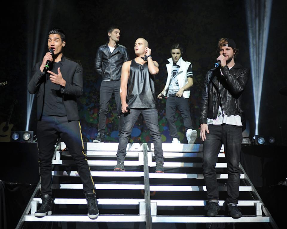 Tom Parker on stage with his bandmates Siva Kaneswaran, Max George, Nathan Sykes and Jay McGuiness. (Getty Images)