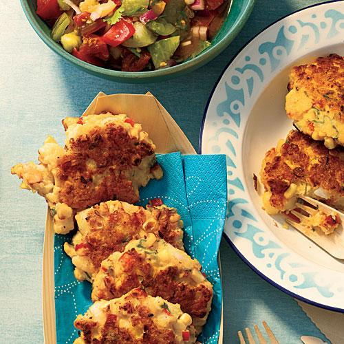 """<p>Delicious patties made of fresh corn, shrimp, and bell pepper are pan-fried to perfection in this recipe. Serrano chile in the heirloom tomato salsa adds a bit of heat, and cilantro some earthy freshness.</p> <p> <a rel=""""nofollow noopener"""" href=""""http://www.myrecipes.com/recipe/shrimp-corn-cakes"""" target=""""_blank"""" data-ylk=""""slk:View Recipe: Shrimp and Corn Cakes with Heirloom Tomato Salsa"""" class=""""link rapid-noclick-resp""""> View Recipe: Shrimp and Corn Cakes with Heirloom Tomato Salsa</a></p>"""
