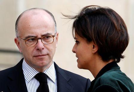French Interior Minister Bernard Cazeneuve (L) speaks with Education and Research minister Najat Vallaud-Belkacem as they leave after a meeting on Ebola at the Elysee Palace in Paris October 13, 2014. REUTERS/Charles Platiau